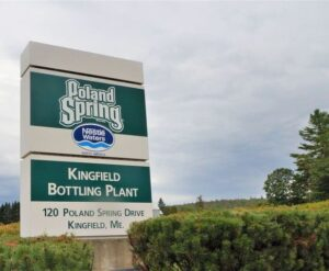 photo of the poland springs sign outside the kingfield bottling plant